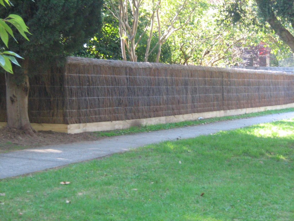 brushwood fence on retaining wall